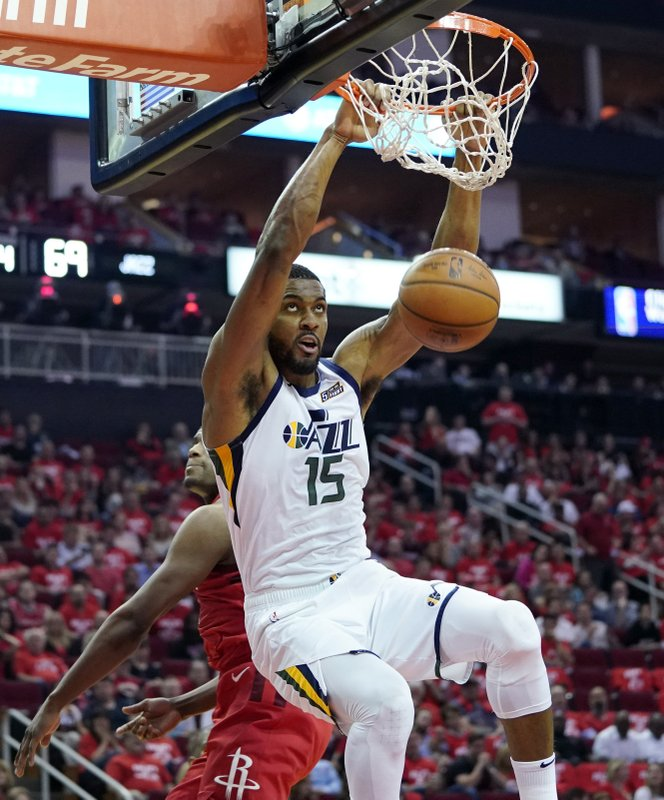 Utah Jazz forward Derrick Favors (15) scores against the Houston Rockets during the second half in Game 5 of an NBA basketball playoff series, in Houston, Wednesday, April 24, 2019. (AP Photo/David J. Phillip)