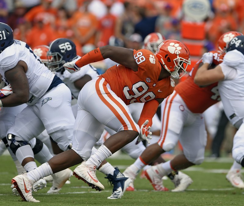 FILE - In this Sept. 15, 2018, file photo, Clemson's Clelin Ferrell (99) rushes into the backfield during the first half of an NCAA college football game against Georgia Southern, in Clemson, S. (AP Photo/Richard Shiro, File)