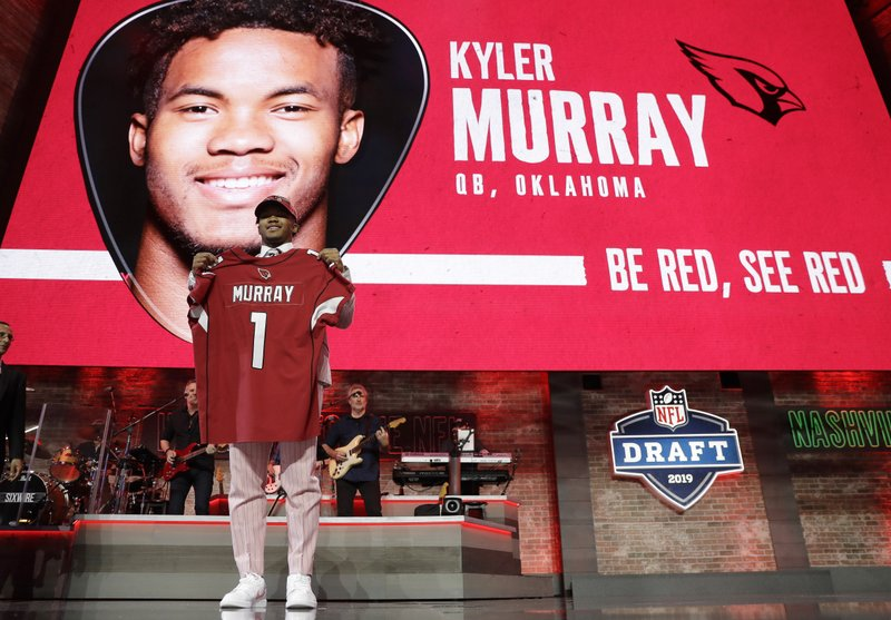 Oklahoma quarterback Kyler Murray shows off his new jersey after the Arizona Cardinals selected Murray in the first round at the NFL football draft, Thursday, April 25, 2019, in Nashville, Tenn. (AP Photo/Mark Humphrey)