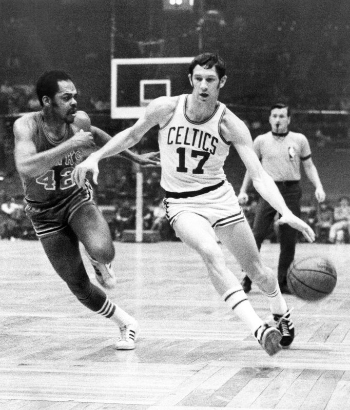 FILE - In this Jan. 8, 1970 file photo, Boston Celtics' John Havlicek (17) protects ball with his body from Atlanta Hawks' Walt Hazzard (42) during an NBA basketball game in Boston. (AP Photo/File)