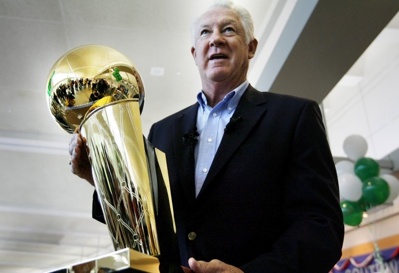 FILE - In this Wednesday, June 4, 2008 file photo, NBA legend John Havlicek holds the Larry O'Brien NBA Championship Trophy at Manchester Boston Regional Airport in Manchester, N. (AP Photo/Cheryl Senter, File)