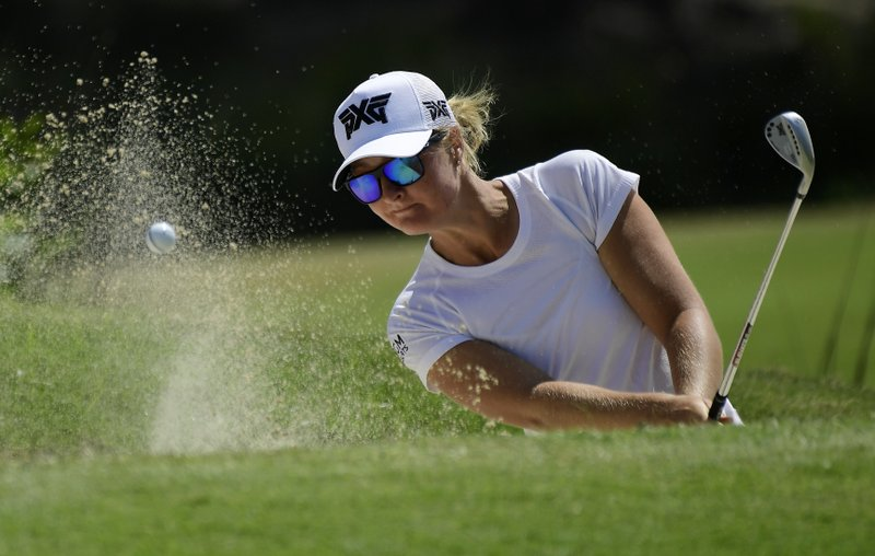Anna Nordqvist, of Sweden, hits out of a bunker on the fourth hole during the first round of the HUGEL-Air Premia LA Open golf tournament at Wilshire Country Club Thursday, April 25, 2019, in Los Angeles. (AP Photo/Mark J. Terrill)