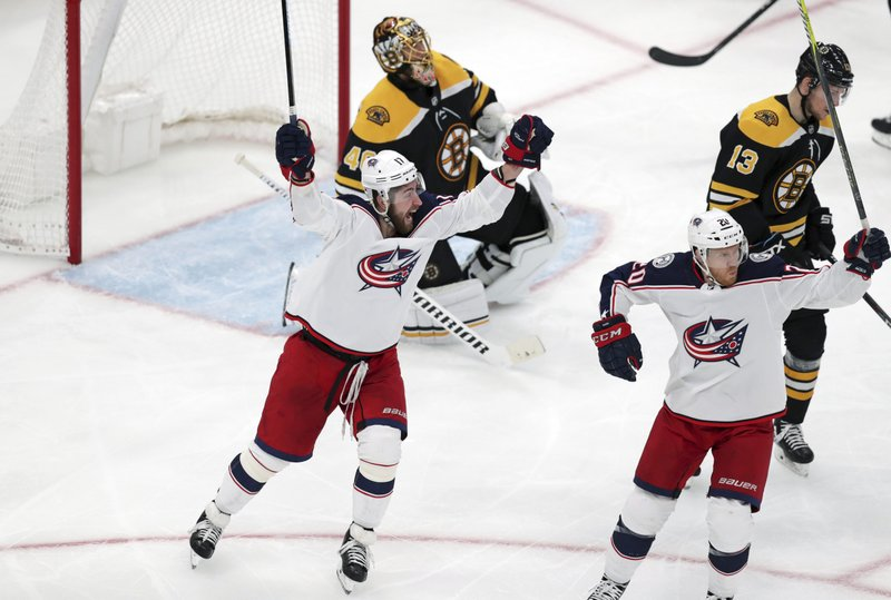 Columbus Blue Jackets center Riley Nash, right, celebrates with Brandon Dubinsky, left, after his goal off Boston Bruins goaltender Tuukka Rask during the third period of Game 1 of an NHL hockey second-round playoff series, Thursday, April 25, 2019, in Boston. (13). (AP Photo/Charles Krupa)