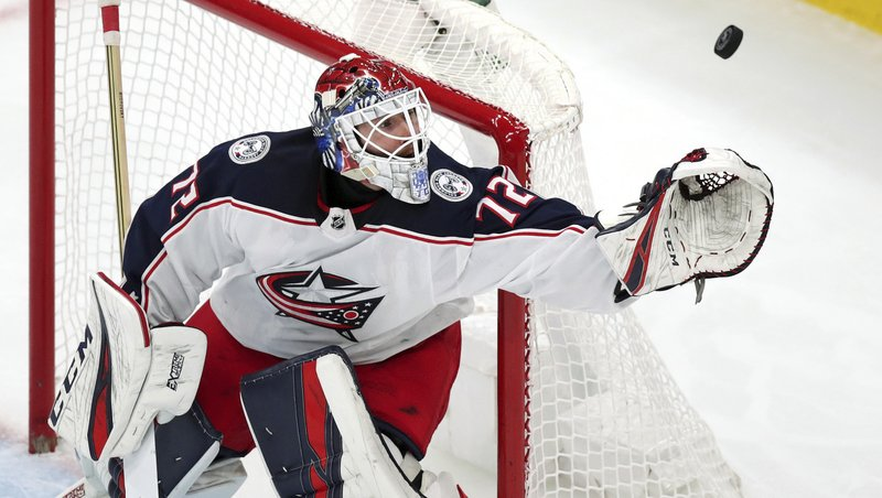 Columbus Blue Jackets goaltender Sergei Bobrovsky reaches for the puck on a save during the third period of Game 1 of an NHL hockey second-round playoff series against the Boston Bruins, Thursday, April 25, 2019, in Boston. (AP Photo/Charles Krupa)