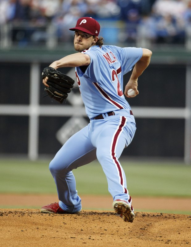 Philadelphia Phillies starting pitcher Aaron Nola throws a pitch during the first inning of a baseball game against the Miami Marlins, Thursday, April 25, 2019, in Philadelphia. (AP Photo/Chris Szagola)