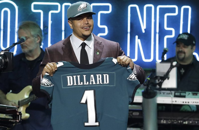 Washington State tackle Andre Dillard shows off his new jersey after the Philadelphia Eagles selected him in the first round at the NFL football draft, Thursday, April 25, 2019, in Nashville, Tenn. (AP Photo/Steve Helber)