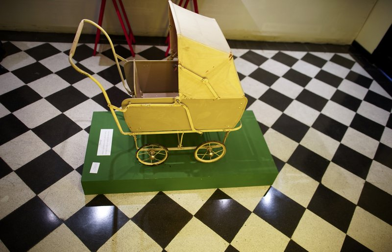 A toy baby carriage of the