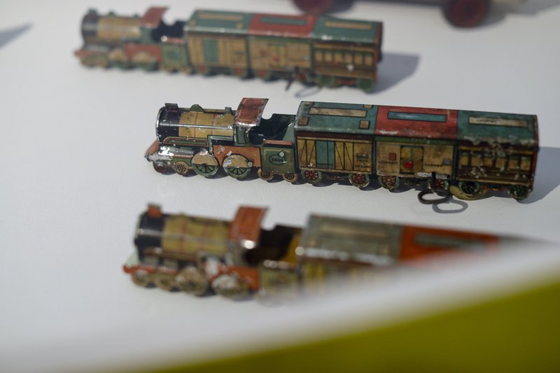 Tin toy trains are displayed at the