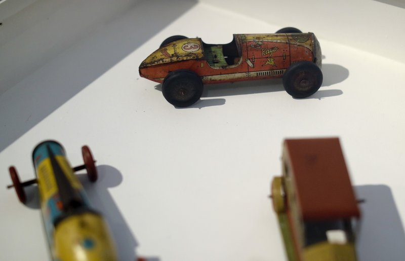 Tin toy cars are displayed at