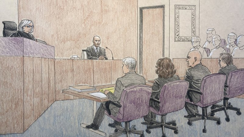 This courtroom sketch depicts former Minneapolis police officer Mohamed Noor, center, on the witness stand Thursday, April 25, 2019, in Minneapolis during his trial in the fatal shooting of an unarmed Australian woman, Justine Ruszczyk Damond, in July 2017 after she called 911 to report a possible sexual assault behind her home. (Cedric Hohnstadt via AP)