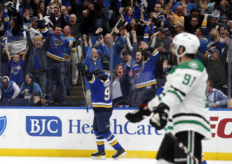 Fans and St. Louis Blues' Vladimir Tarasenko, center, celebrate a goal by Tarasenko as Dallas Stars' Tyler Seguin (91) looks on during the second period in Game 1 of an NHL second-round hockey playoff series Thursday, April 25, 2019, in St. (AP Photo/Jeff Roberson)