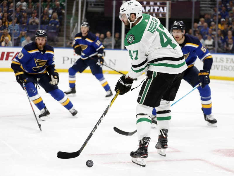 Dallas Stars right wing Alexander Radulov (47) handles the puck as St. Louis Blues' Ryan O'Reilly (90), Jay Bouwmeester (19) and Colton Parayko, right rear, defend during the first period in Game 1 of an NHL second-round hockey playoff series Thursday, April 25, 2019, in St. (AP Photo/Jeff Roberson)
