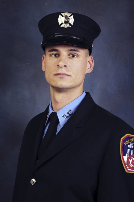 FILE - This undated, file photo provided on April 9, 2019, by the Fire Department of New York shows firefighter Christopher Slutman. (Fire Department of New York via AP, File)