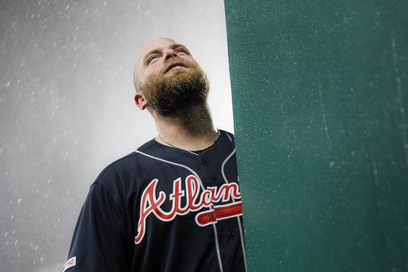 Atlanta Braves catcher Brian McCann stands in the dugout during a rain delay in the seventh inning of a baseball game against the Cincinnati Reds, Thursday, April 25, 2019, in Cincinnati. (AP Photo/John Minchillo)