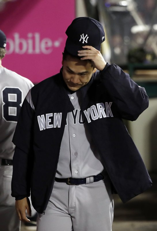 New York Yankees starting pitcher Masahiro Tanaka walks in the dugout during the sixth inning of a baseball game against the Los Angeles Angels Thursday, April 25, 2019, in Anaheim, Calif. (AP Photo/Marcio Jose Sanchez)