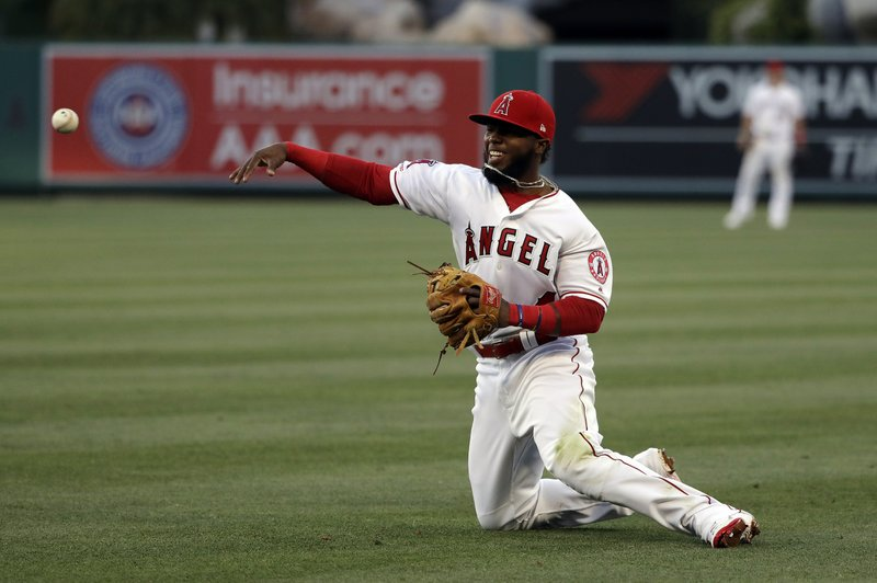 Los Angeles Angels second baseman Luis Rengifo makes a throw from his knees after a ground ball from New York Yankees' Tyler Wade during the third inning of a baseball game Thursday, April 25, 2019, in Anaheim, Calif. (AP Photo/Marcio Jose Sanchez)