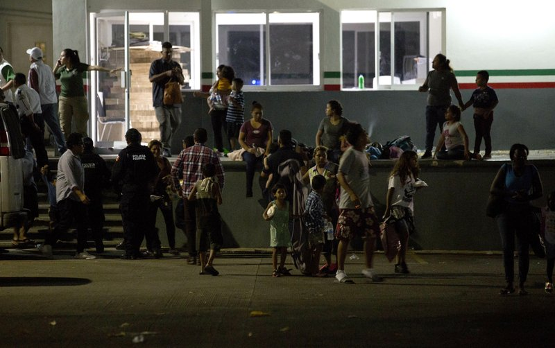 Migrants waits for their transfer from an immigration detention center in Tapachula, Chiapas state, Mexico, Thursday, April 25, 2019. (AP Photo/Moises Castillo)