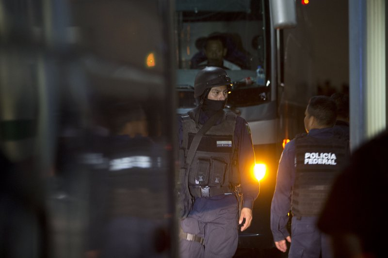 Federal police enter an immigration detention center in Tapachula, Chiapas state, Mexico, late Thursday, April 25, 2019. (AP Photo/Moises Castillo)