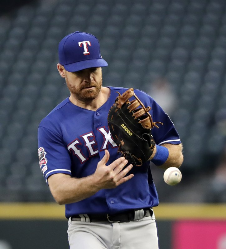 Texas Rangers second baseman Logan Forsythe misplays a pop foul for an error against the Seattle Mariners in the first inning of a baseball game Thursday, April 25, 2019, in Seattle. (AP Photo/Elaine Thompson)