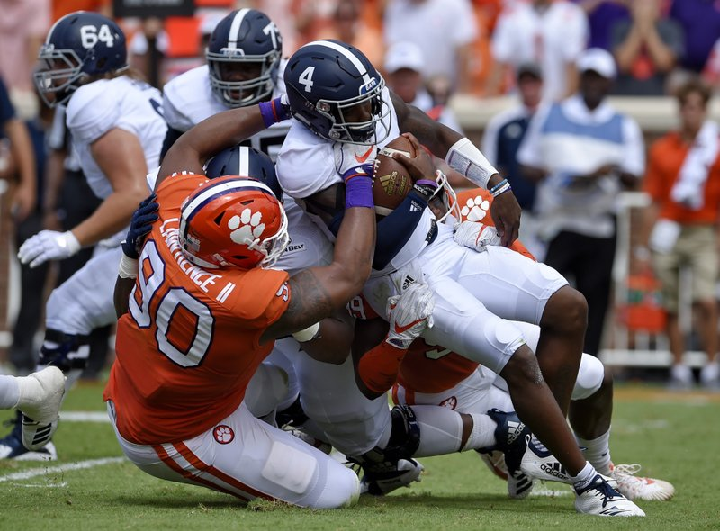 FILE - In this Sept. 15, 2018, file photo, Clemson's Dexter Lawrence brings down Georgia Southern quarterback Shai Werts during the first half of an NCAA college football game, in Clemson, S. (AP Photo/Richard Shiro, File)