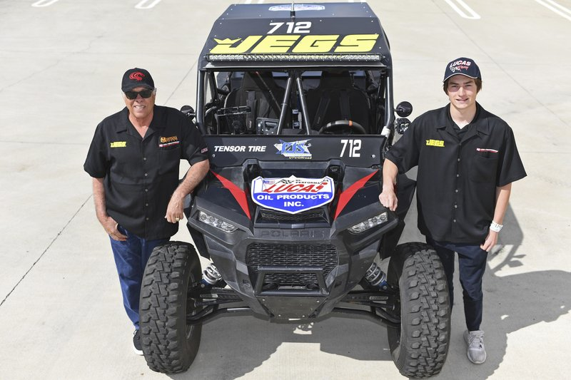 This March 9, 2019, photo provided by Auto Imagery shows former drag racer Don Prudhomme, left, and Jagger Jones at the Snake Racing Performance Shop in Vista, Calif. (Richard Shute/Auto Imagery via AP)