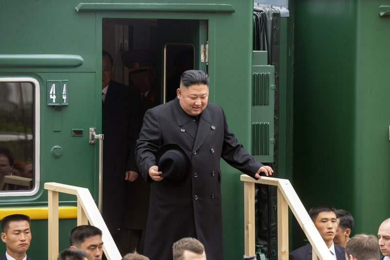 In this photo released by press office of the administration of Primorsky Krai region, North Korea's leader Kim Jong Un leaves a train carriage after arriving at the border station of Khasan, Primorsky Krai region, Russia, Wednesday, April 24, 2019. (Alexander Safronov/Press Office of the Primorye Territory Administration via AP)
