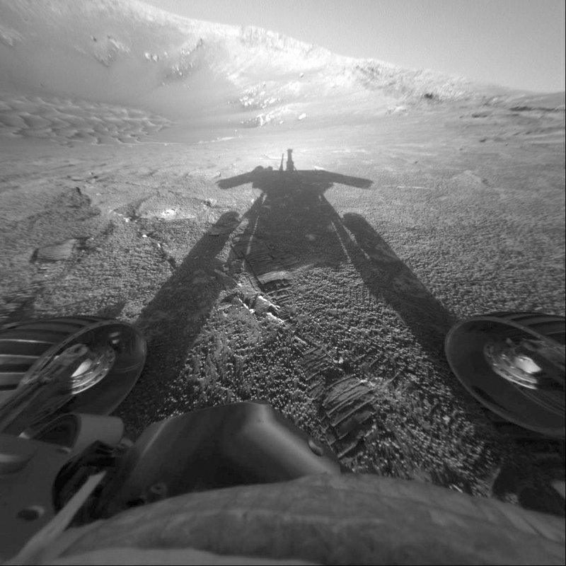 FILE - This July 26, 2004 file photo made available by NASA shows the shadow of the Mars Exploration Rover Opportunity as it traveled farther into Endurance Crater in the Meridiani Planum region of Mars. (NASA/JPL-Caltech via AP, File)
