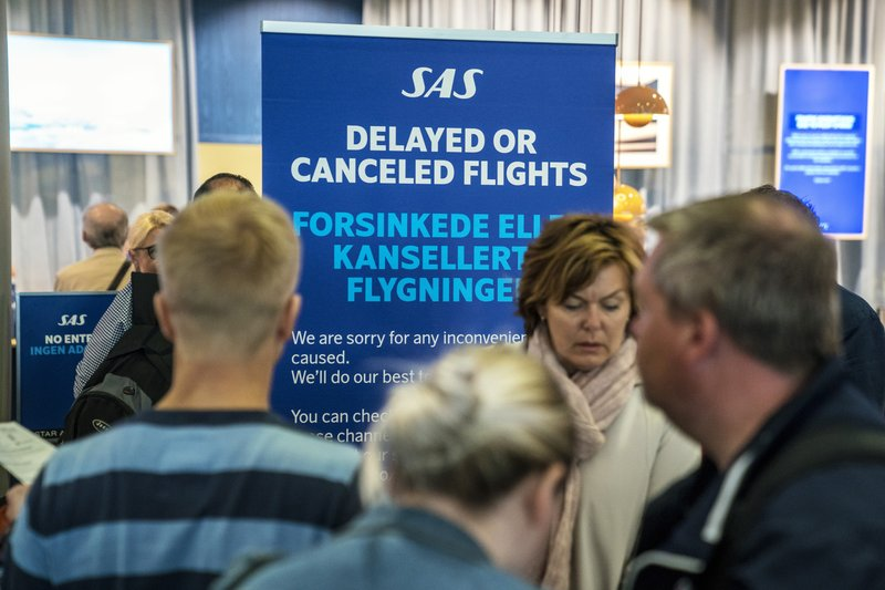 People queue after flights were cancelled by Scandinavian Airlines, at Oslo Airport in Gardermoen, Norway,  Friday, April 26, 2019. (Ole Berg-Rusten/NTB Scanpix via AP)