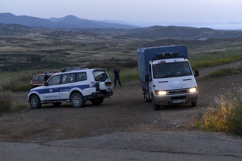 A police truck carries a body found after Cypriot investigators and police officers searched at a field outside of Orounta village, near the capital Nicosia, Cyprus, Thursday, April 25, 2019. (AP Photo)