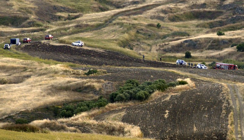 Cypriot investigators and police officers search a field where a body were found, outside of Orounta village, near the capital Nicosia, Cyprus, Monday, April 25, 2019. (AP Photo)
