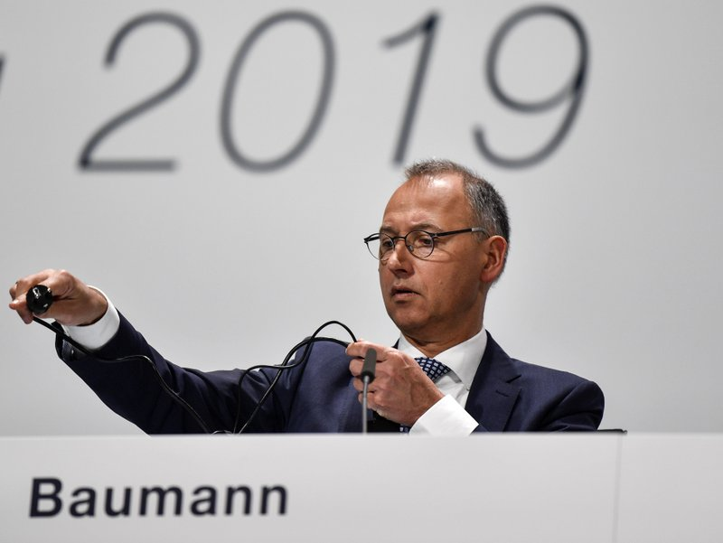 CEO Werner Baumann prepares for the annual general meeting of the Bayer stock company in Bonn, Germany, Friday, April 26, 2019. (AP Photo/Martin Meissner)
