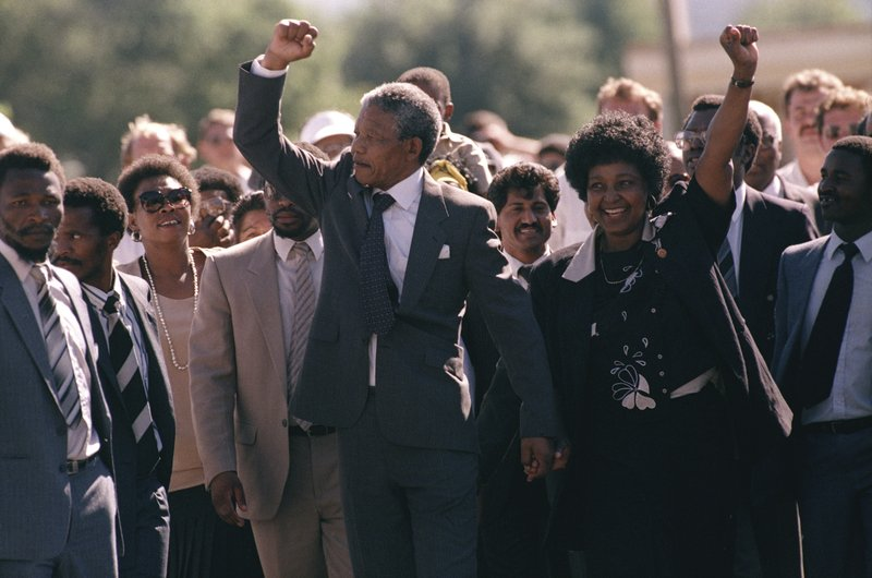 FILE - In this Sunday, Feb. 11, 1990 file photo Nelson Mandela, left, and his wife Winnie, right, leave the Victor Verster prison, near Cape Town, South Africa, ending Nelson Mandela's 27-years of imprisonment under the country's white minority government. (AP Photo/Greg English, File)