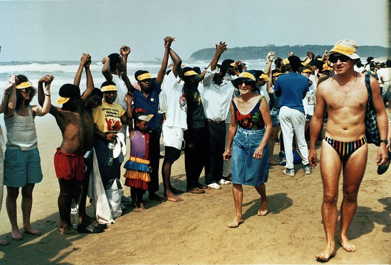 FILE - In this Sept. 1989 file photo white bathers walk past black demonstrators protesting against the beach reserved for