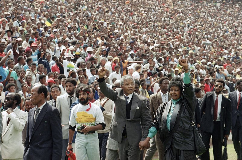 FILE - In this Feb. 13, 1990, file photo, Nelson Mandela and Winnie Mandela give black power salutes as they enter Soccer City stadium in the Soweto township of Johannesburg, South Africa, shortly after his release from 27 years in prison. (AP Photo/Udo Weitz, File)