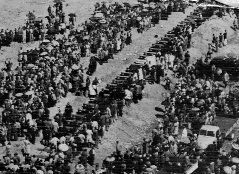 FILE -- In this March 30, 1960 file photo a mass funeral takes place in Sharpeville, South Africa, for victims of the Sharpeville Massacre in which 69 people were killed when police opened fire on demonstrators protesting against government's apartheid policies and the arrest of their leaders. (AP Photo)