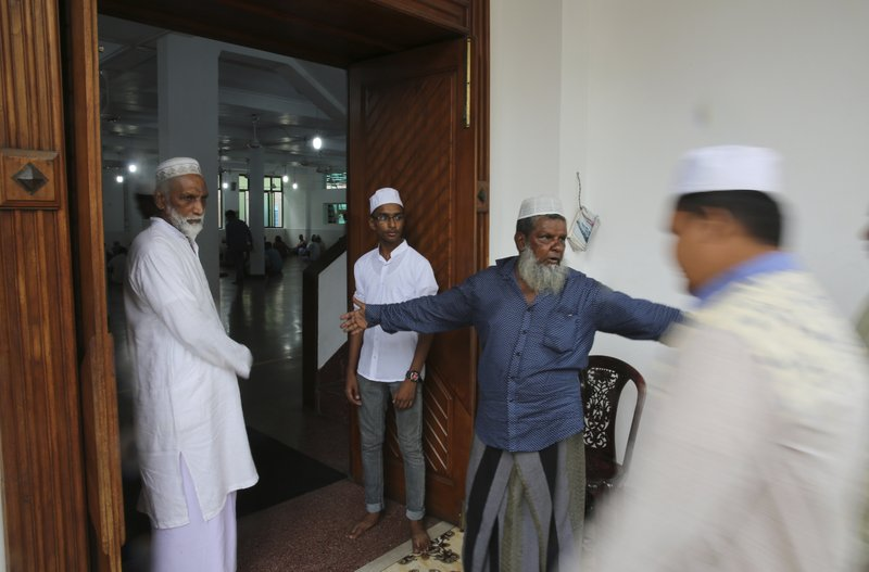 A Sri Lankan Muslim guides people for Friday prayers inside a mosque, in Colombo, Sri Lanka, Friday, April 26, 2019. (AP Photo/Manish Swarup)