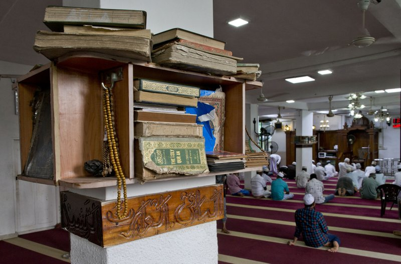 Copies of the holy Quran and prayer breads are kept in a mosque as Muslim men gather to pray in Colombo, Sri Lanka, Friday, April 26, 2019. (AP Photo/Gemunu Amarasinghe)