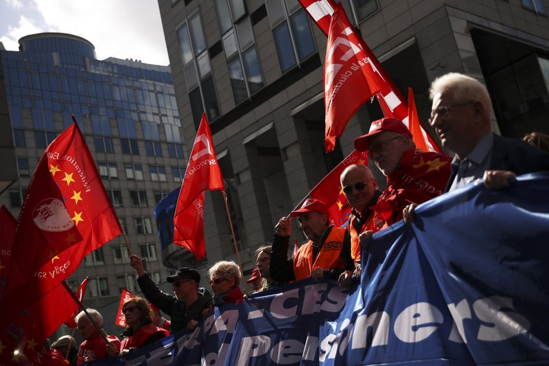 People march during a protest by European trade unions in Brussels, Friday, April 26, 2019. Thousands of trade union demonstrators protested outside of European Union headquarters to demand better protection and working conditions in the wake of next month's EU-wide elections. (AP Photo/Francisco Seco)