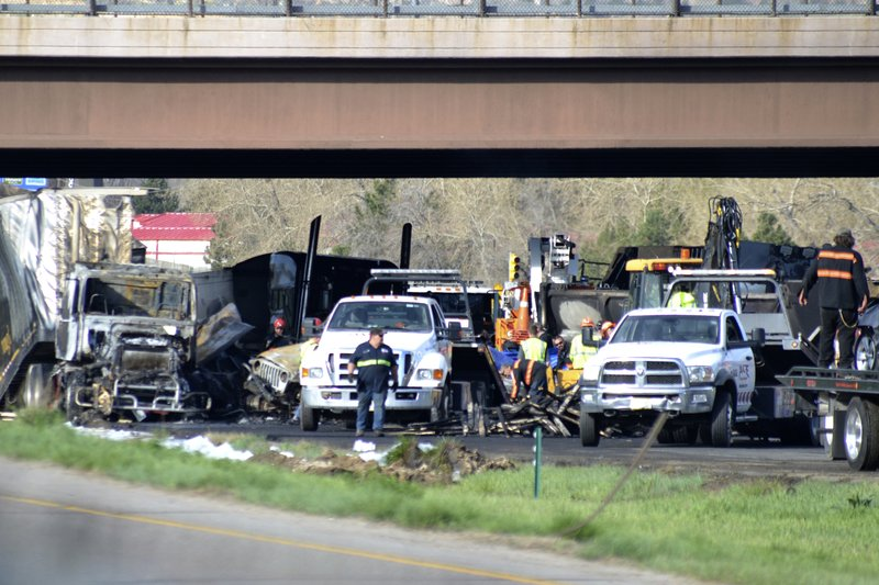 Authorities survey the scene of a fiery crash on I-70 near Colorado Mills Parkway that shut down the highway in both directions on Friday, April 26, 2019. (AP Photo/Peter Banda)