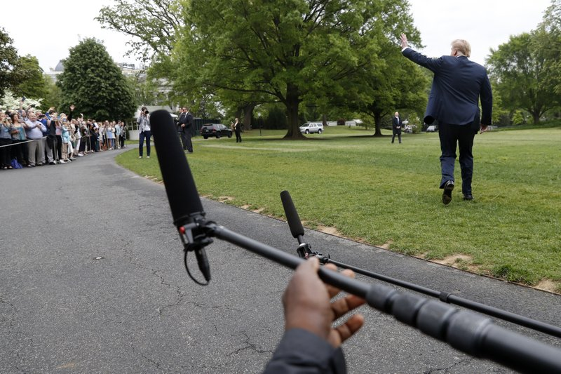 President Donald Trump waves to people watching as he walks across the South Lawn of the White House, Friday April 26, 2019, to leave Washington en route to Indianapolis where he will speak at the annual meeting of the National Rifle Association. (AP Photo/Jacquelyn Martin)