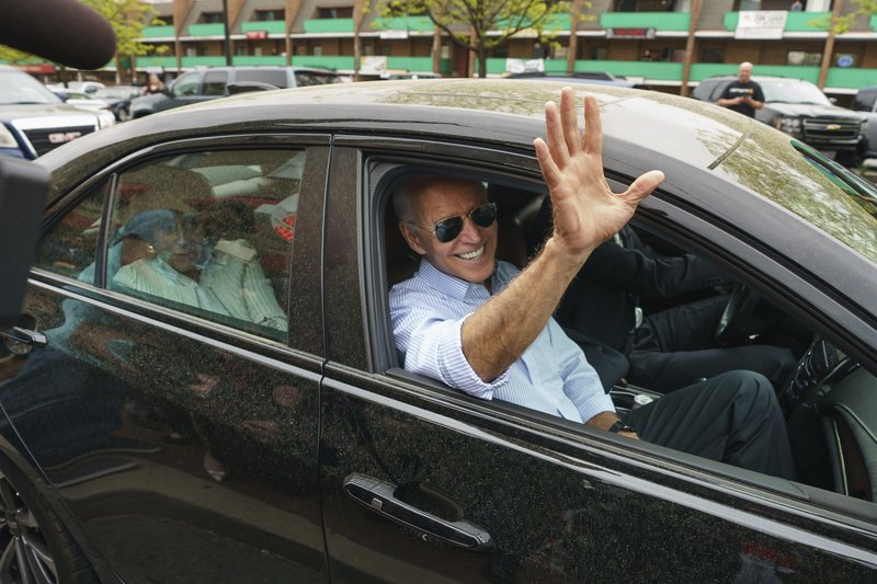 Democratic presidential candidate and former Vice President Joe Biden waves goodbye after stopping at Gianni's Pizza, in Wilmington Del., Thursday, April 25, 2019. Jessica Griffin/The Philadelphia Inquirer via AP)