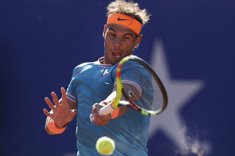 Rafael Nadal of Spain plays a shot against Jan-Lennard Struff of Germany during a quarterfinal match at the Barcelona Open Tennis Tournament in Barcelona, Spain, Friday, April 26, 2019. (AP Photo/Manu Fernandez)