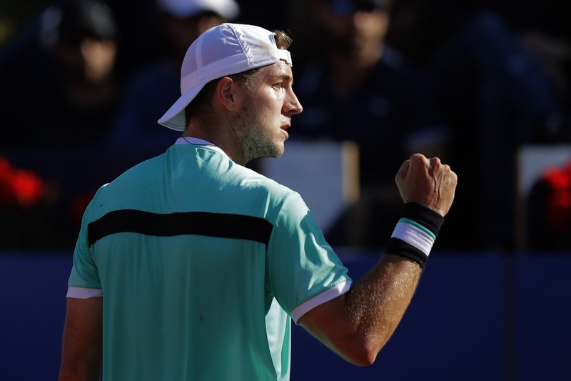 Jan-Lennard Struff of Germany clenches his fist after scoring a point against Rafael Nadal of Spain during a quarterfinal match at the Barcelona Open Tennis Tournament in Barcelona, Spain, Friday, April 26, 2019. (AP Photo/Manu Fernandez)