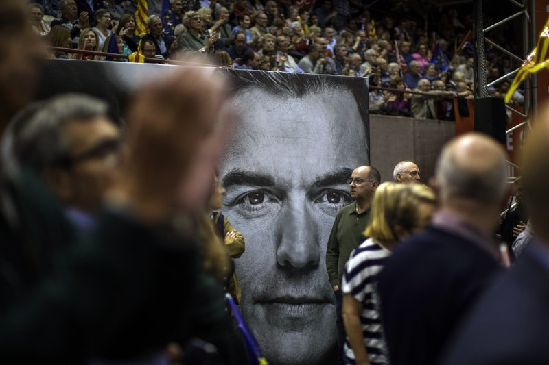 A poster with a portrait of Spanish Prime Minister and Socialist Party candidate Pedro Sanchez is seen during an election campaign event in Barcelona, Spain, Thursday, April 25, 2019. (AP Photo/Emilio Morenatti)