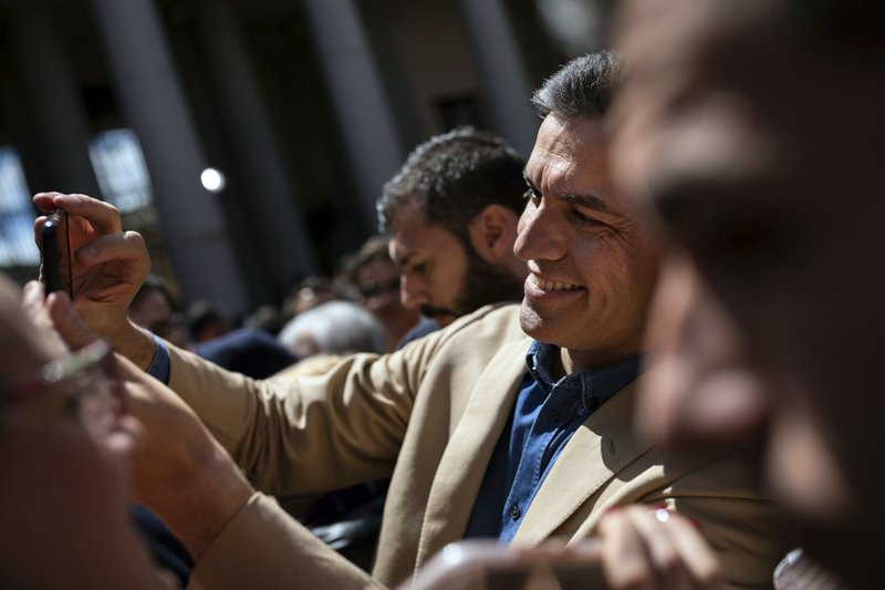Spanish Prime Minister and Socialist Party candidate Pedro Sanchez, center, takes a selfie during an election campaign event in Toledo, central Spain, Friday, April 26, 2019. (AP Photo/Bernat Armangue)