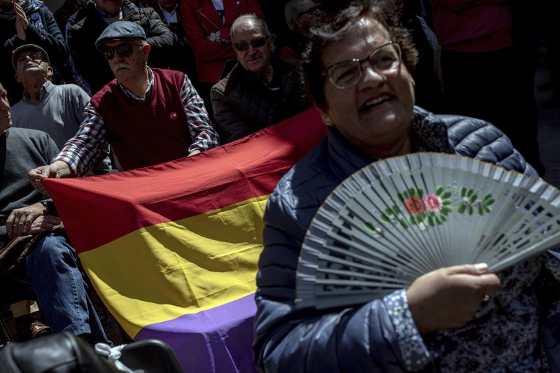 Elderly men display a Spanish Republican flag during an election campaign event hosted by Spanish Prime Minister and Socialist Party candidate Pedro Sanchez in Toledo, central Spain, Friday, April 26, 2019. (AP Photo/Bernat Armangue)
