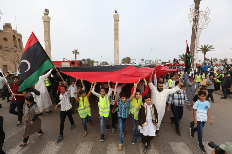 Protesters march against military operations by Field Marshal Khalifa Hifter's forces in Martyrs' Square on in Tripoli, Libya on Friday, April 26, 2019. (AP Photo/Hazem Ahmed)