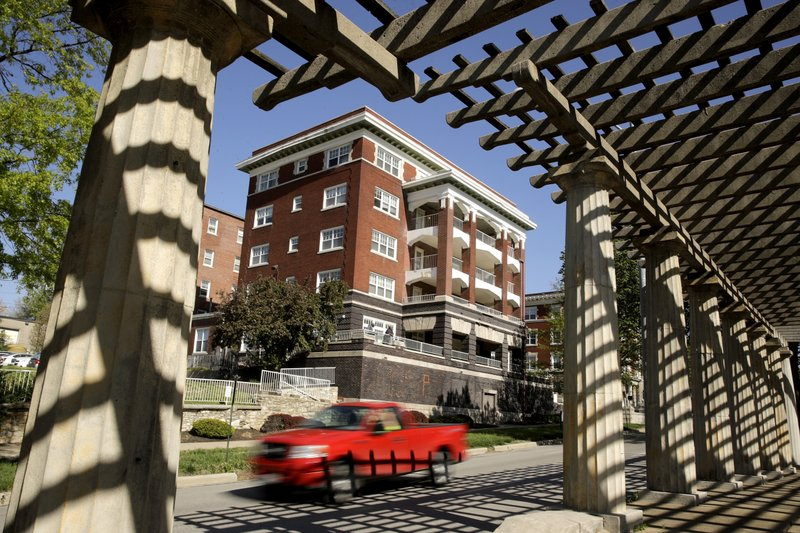 A motorist is framed by an ornate pergola in the median of the newly-named Dr. Martin Luther King Jr. (AP Photo/Charlie Riedel)