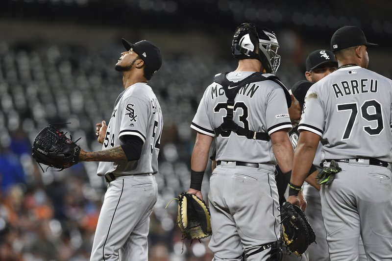 Chicago White Sox pitcher Ervin Santana, left, walks to the dugout during a pitching change in the fifth inning of a baseball game against the Baltimore Orioles, Wednesday, April 24, 2019, in Baltimore. (AP Photo/Gail Burton)