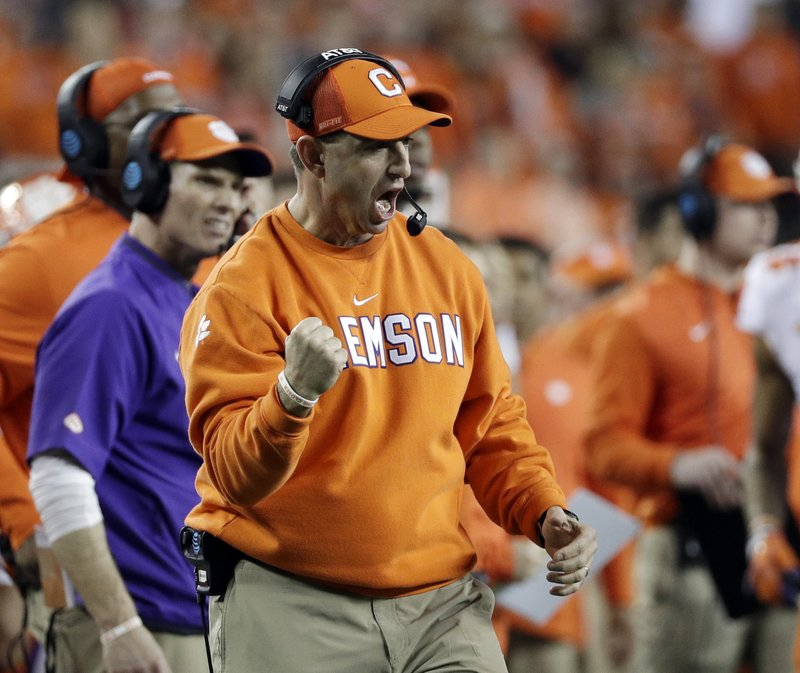 FILE - In this Jan. 7, 2019, file photo, Clemson head coach Dabo Swinney reacts after his defense held on a fourth down play during the second half of the NCAA college football playoff championship game against Alabama, in Santa Clara, Calif. (AP Photo/David J. Phillip, File)